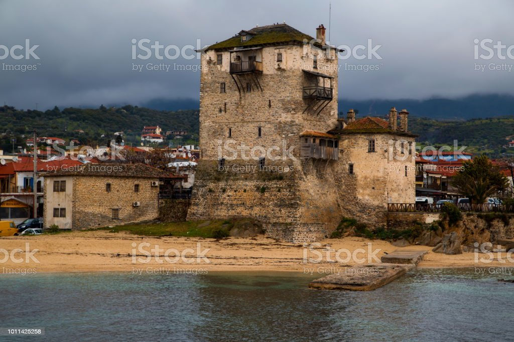 Byzantinum tower in Ouranoupoli of Chalkidiki near mount Athos in Greece stock photo