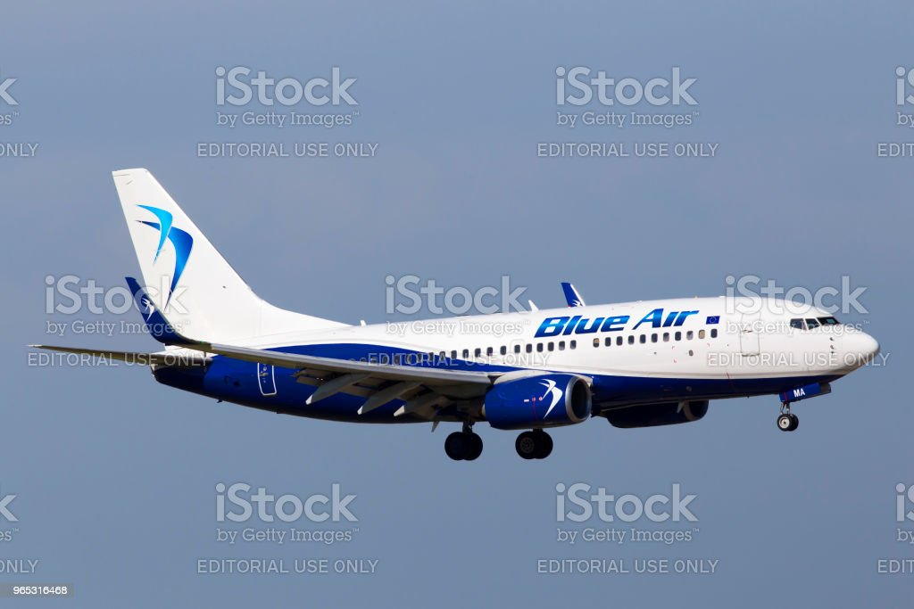 YR-BMA c Boeing 737-700  aircraft on the blue sky background royalty-free stock photo