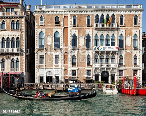 Venice, Italy - October 10, 2014: The late Venetian Palace' Gothic style on Grand Canal, facing the St. Mark's basin, hosts the Venice Biennal' headquarter.