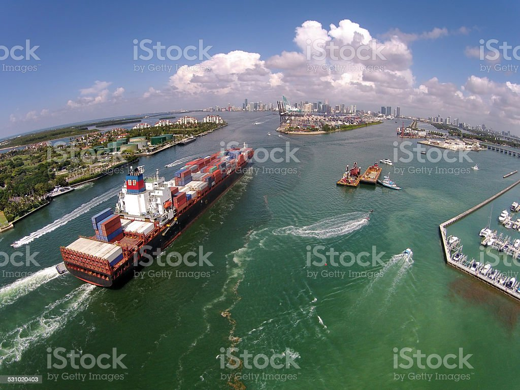 Caargo ship enters port aerial view stock photo