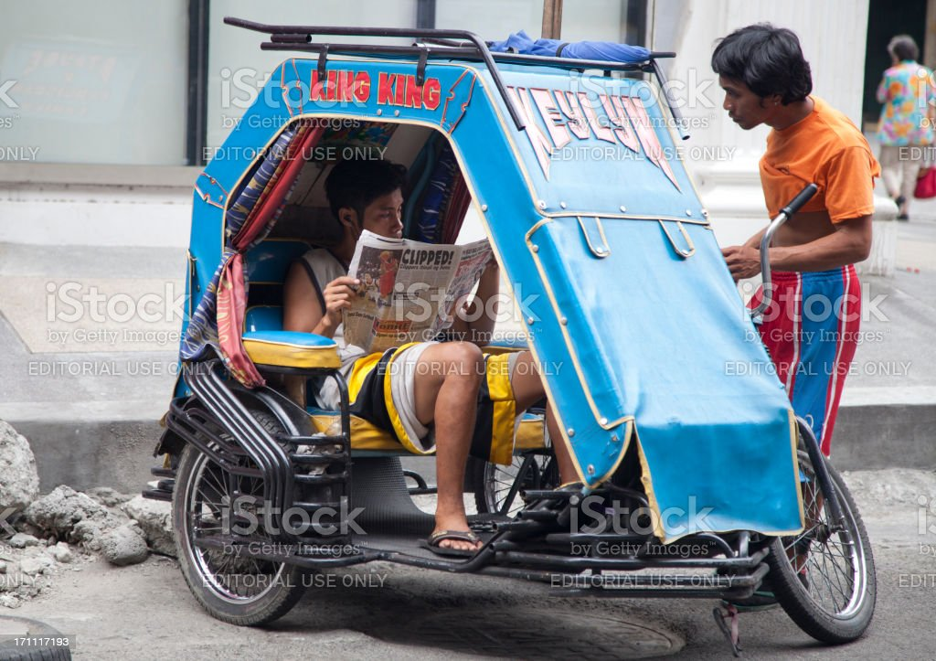 Cab Driver Reads Newspaper stock photo