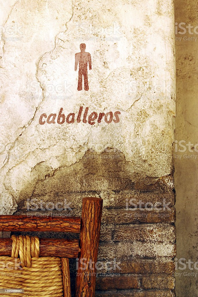 Caballeros painted on stucco and brick stock photo