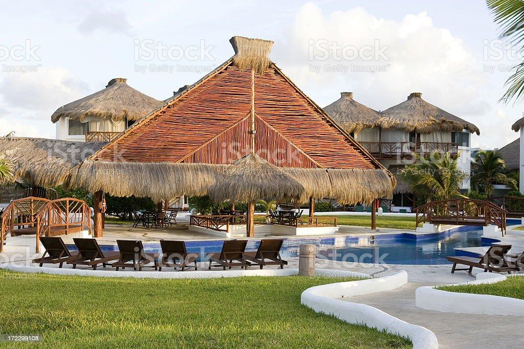 Cabana and Swimming Pool at Tropical Resort royalty-free stock photo