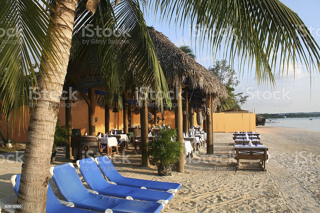 Cabanas and chairs on the beach of a Caribbean Beach Resort stock photo