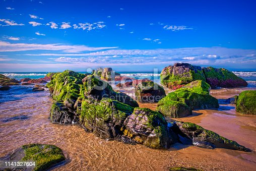 Rocky outcrop at Cabarita Beach at Kingscliff on a sunny day