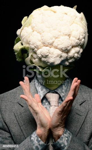 What a cabbage head! For this composite, a man, a cauliflower and a broccoli were sacrificed. Self portrait. Some digital grain added.