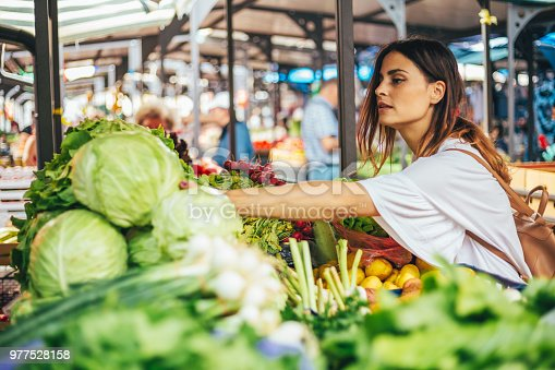 Young cheerful woman at the market