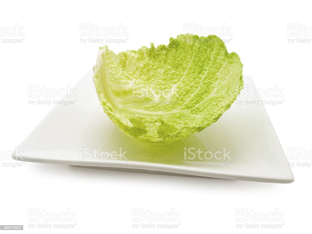 cabbage leaf at plate stock photo