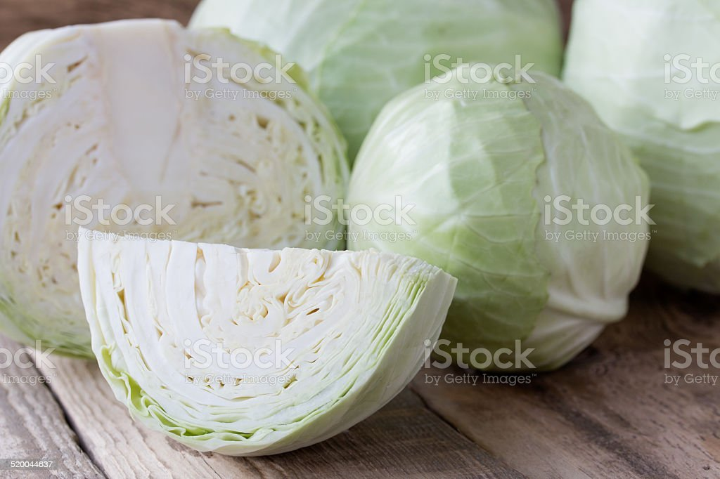 Cabbage on wooden background stock photo