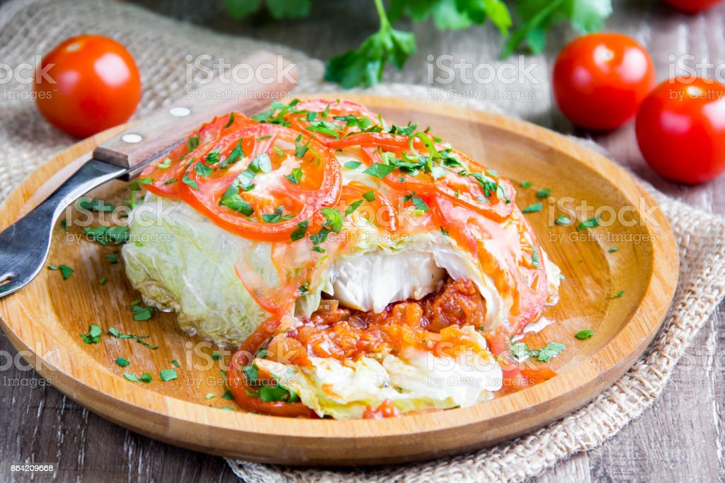 Cabbage rolls, stuffed with tomatoes, fish, meat, vegetables, a delicious Russian dish, healthy diet food royalty-free stock photo