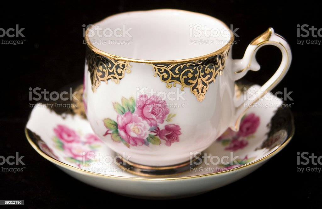 Cabbage Rose teacup & saucer on black stock photo
