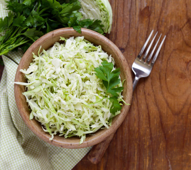 cabbage salad coleslaw on a wooden table - coleslaw stock pictures, royalty-free photos & images