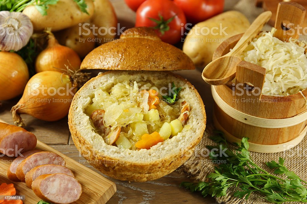 Cabbage soup in a loaf of bread stock photo