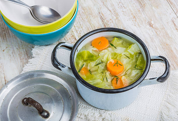 Cabbage soup in a pot stock photo