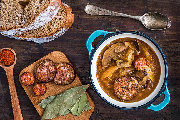 Cabbage Soup Kapustnica Traditional Sour Cabbage Soup with Sausage and Mushrooms czech culture stock pictures, royalty-free photos & images