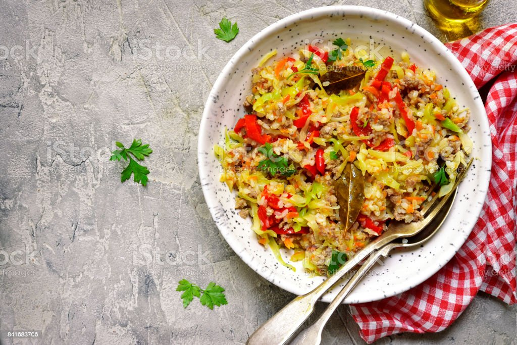 Cabbage stewed with bell pepper,minced meat and rice stock photo