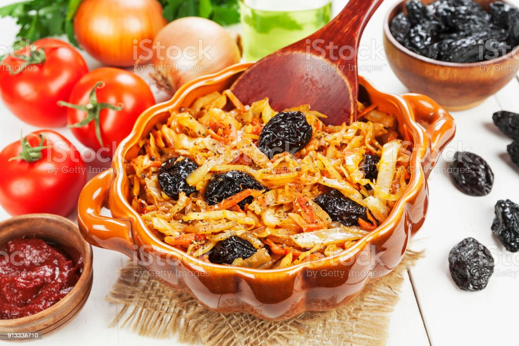 Cabbage stewed with prunes stock photo