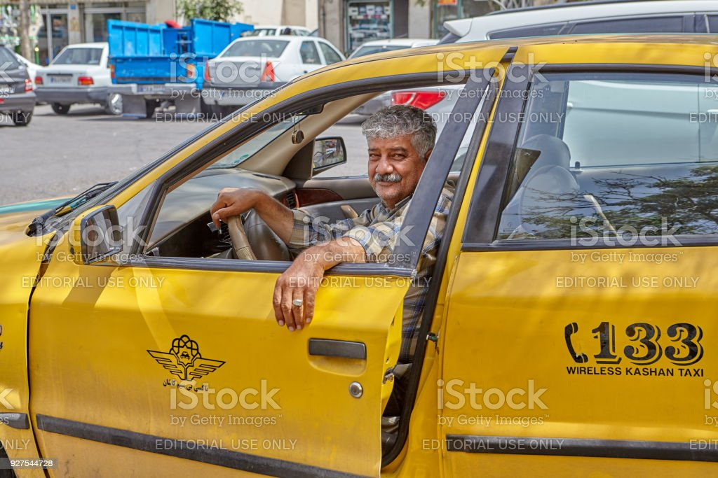 Cabdriver is resting in the car in cabstand, Kashan, Iran. stock photo
