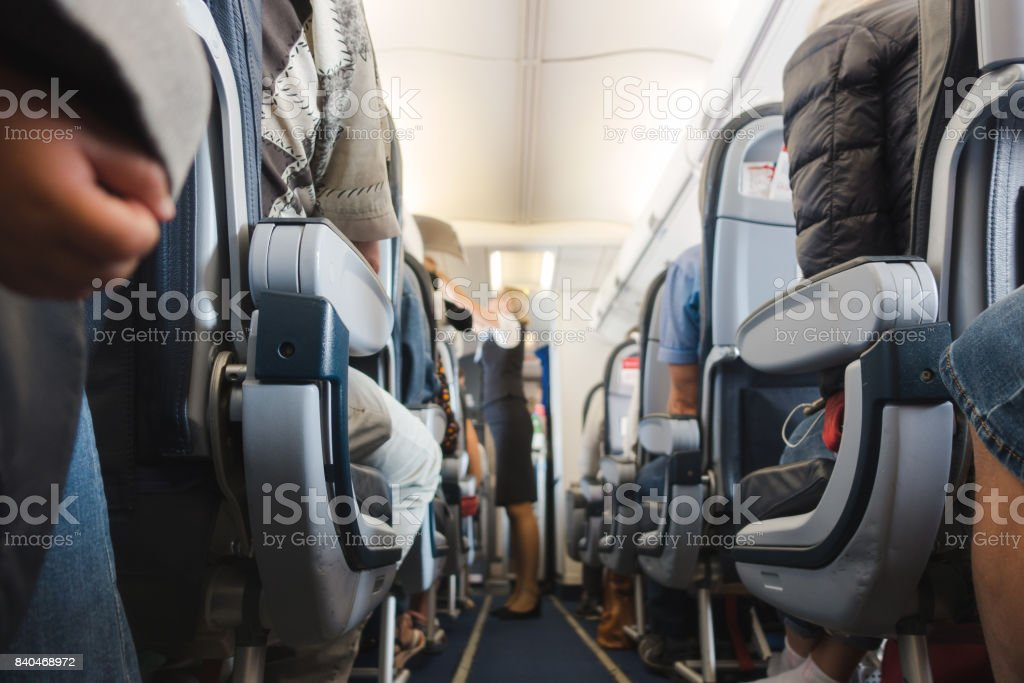 Cabin aisle in airplane stock photo