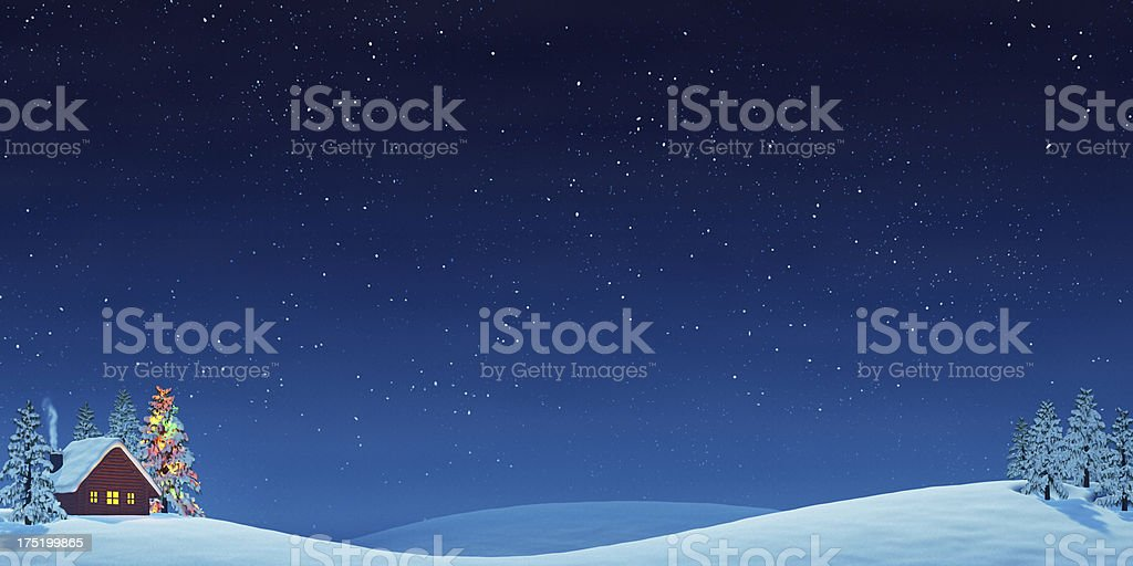 Cabin and Christmas tree in rolling winter landscape at night stock photo