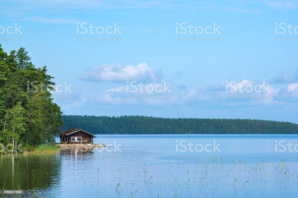 Cabin and lake stock photo