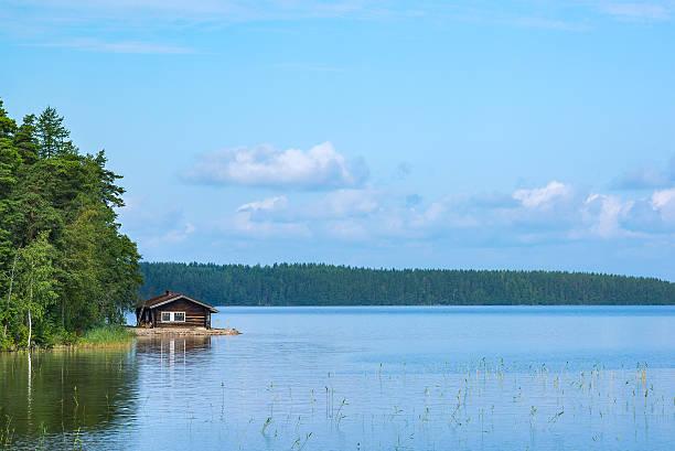 Cabin and lake stock photo