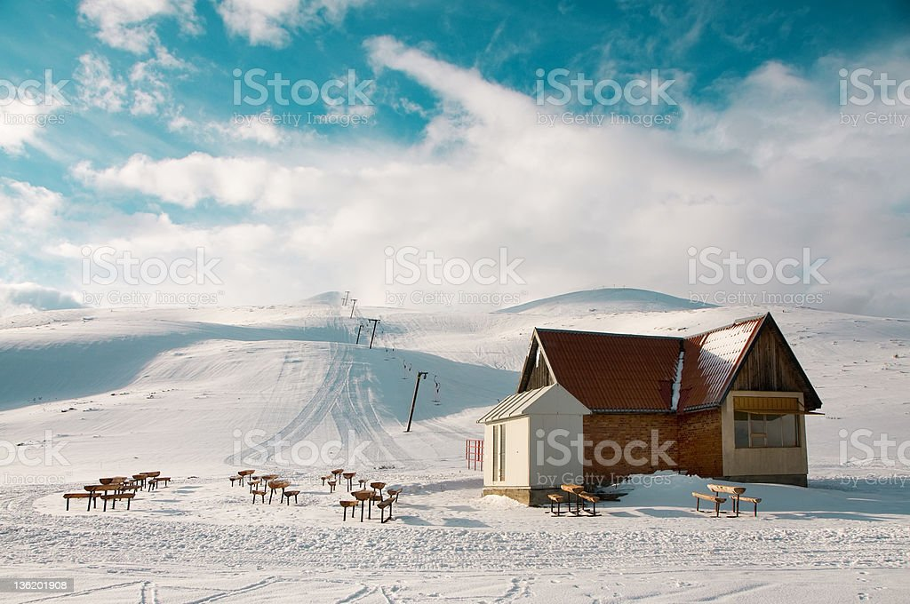 Cabin and Ski lift up a mountain royalty-free stock photo