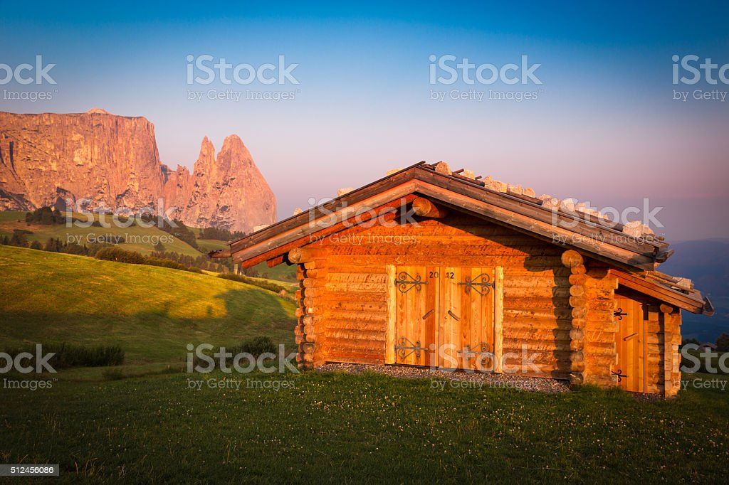 Cabin at Seiser Alm with Schlern mountain, South Tyrol, Italy stock photo