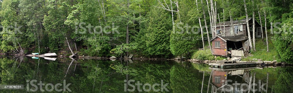 Cabin at the lake stock photo