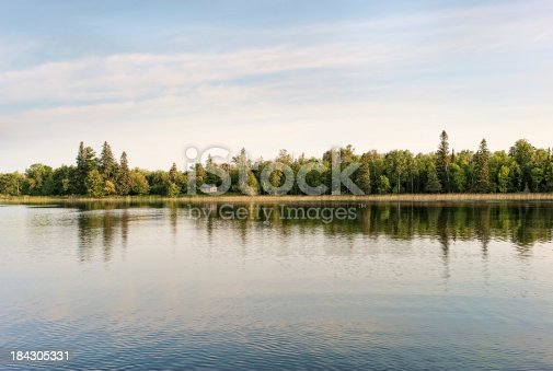 876420064istockphoto Cabin by the lake 184305331