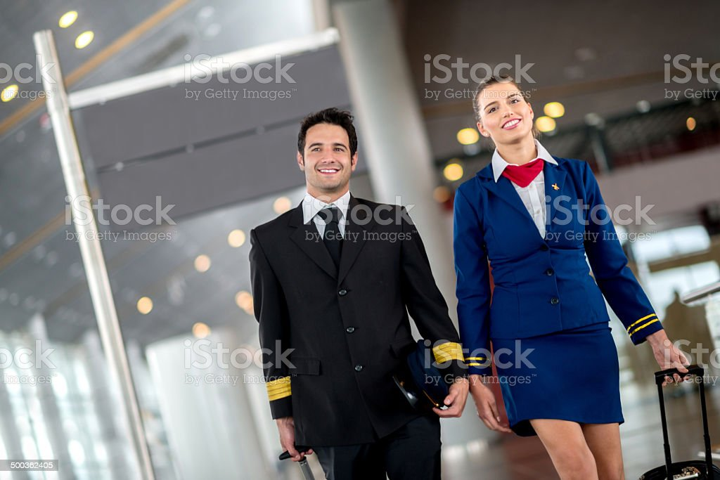 Cabin crew at the airport stock photo