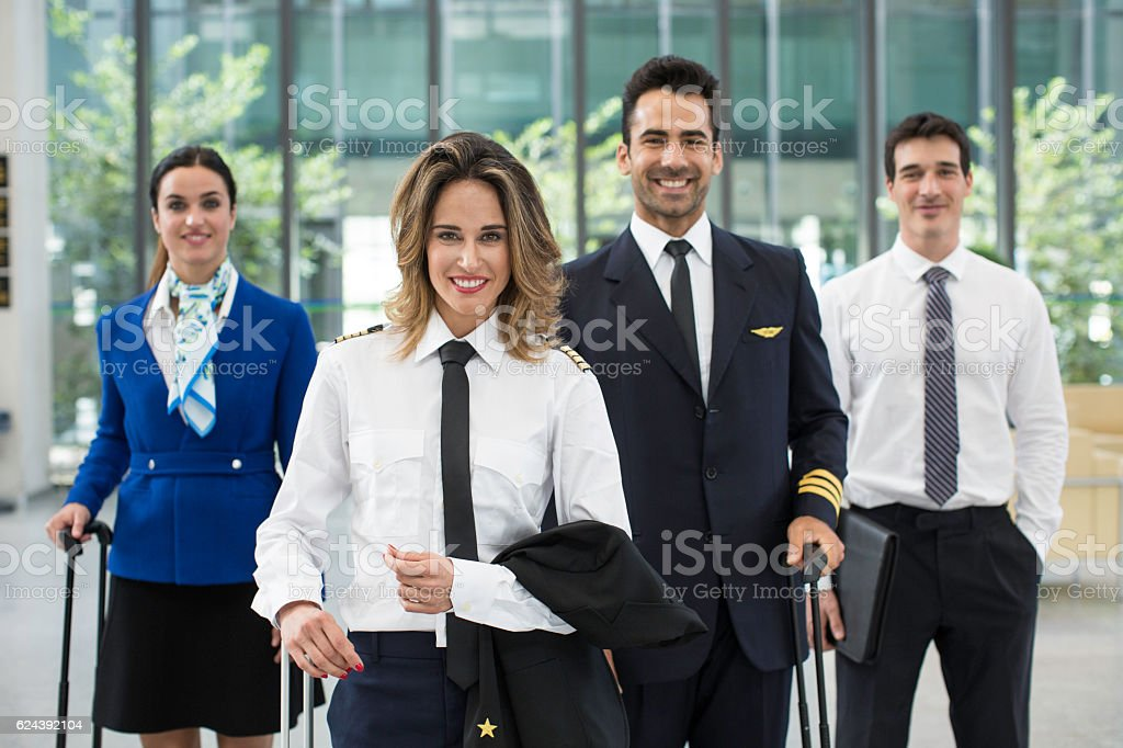 Cabin crew portrait looking at camera. stock photo
