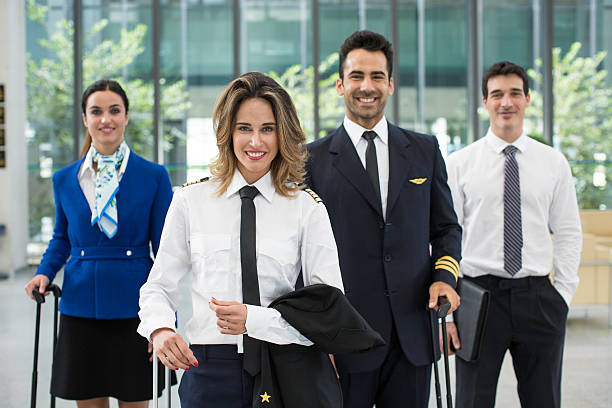 Cabin crew portrait looking at camera. Cabin crew portrait looking at camera. cabin crew stock pictures, royalty-free photos & images
