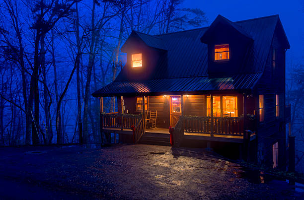 Cabin in the Mountains at night View of typical cabin log in the Smoky Mountain National Park area. pigeon forge stock pictures, royalty-free photos & images