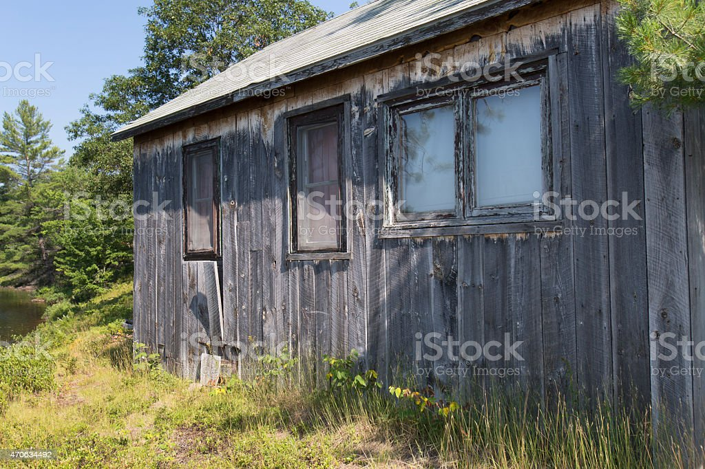 cabin in the woods stock photo