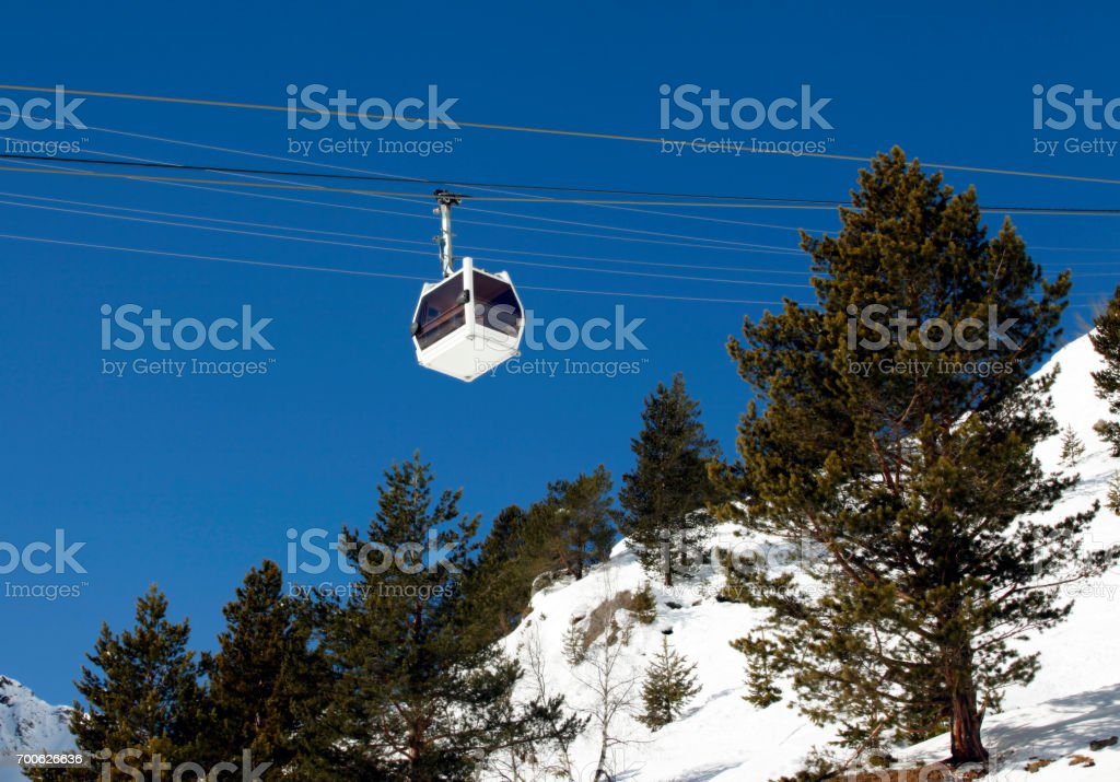 Cabin lift of a ski resort on a background of the dark blue sky stock photo