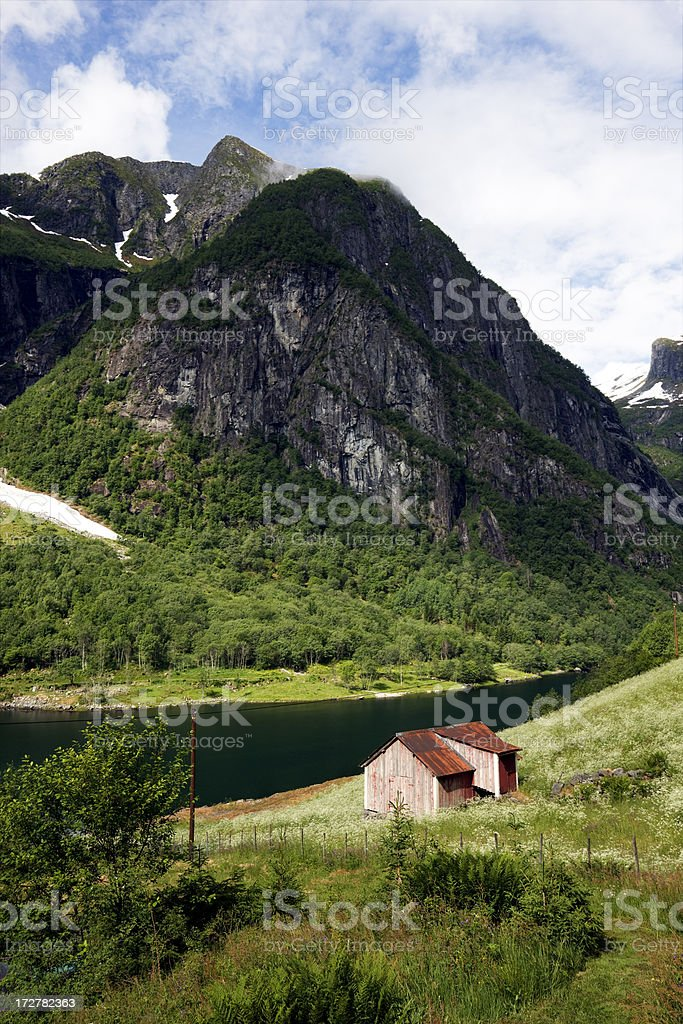 Cabin, Meadow and Mountain royalty-free stock photo