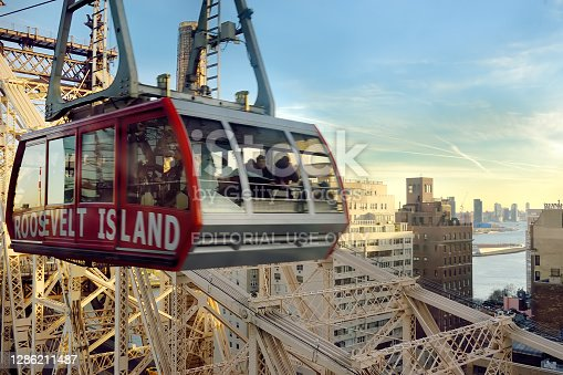istock Cabin of the famous Roosevelt Island cable car in front of the Ed Coch Queensboro Bridge from Manhattan to Queens in New York. 1286211487