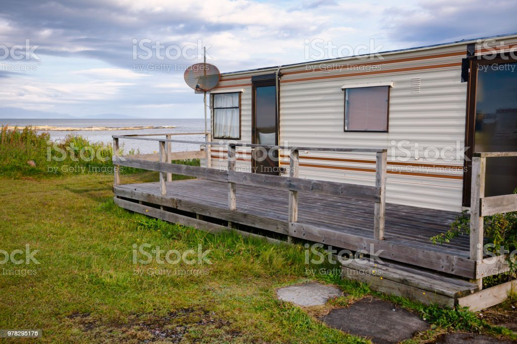 Cabin on ocean shore at Scottish Highlands stock photo