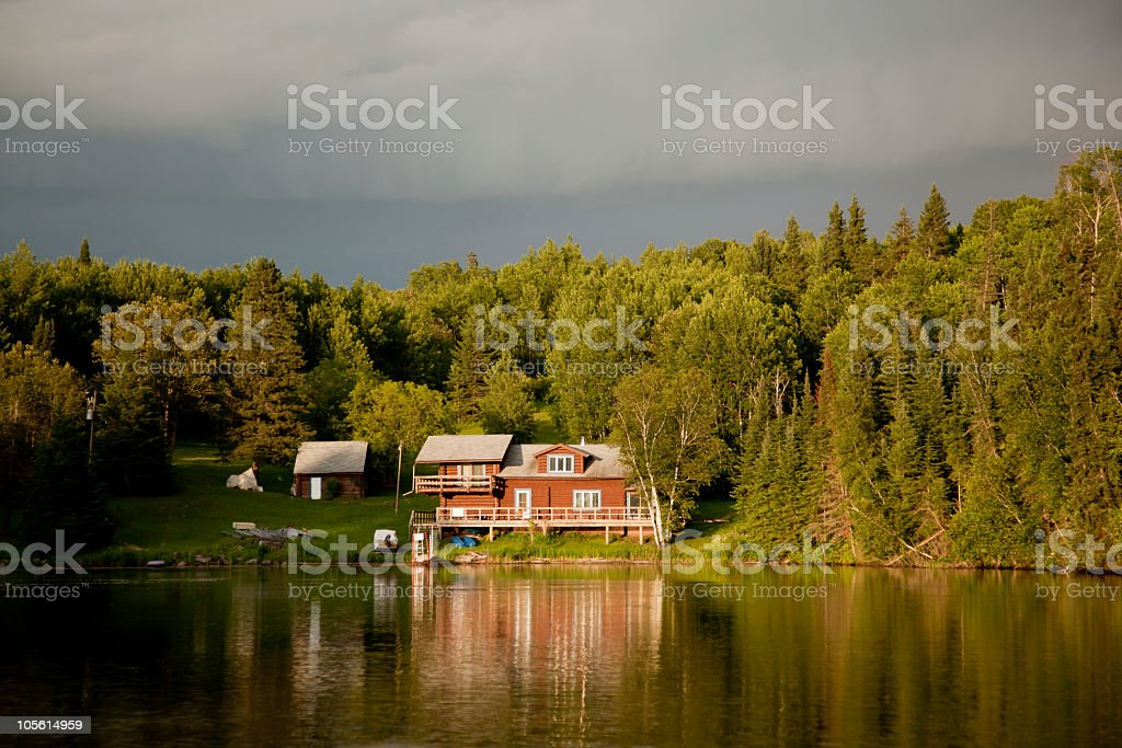 Cabin on the lake at sunset royalty-free stock photo
