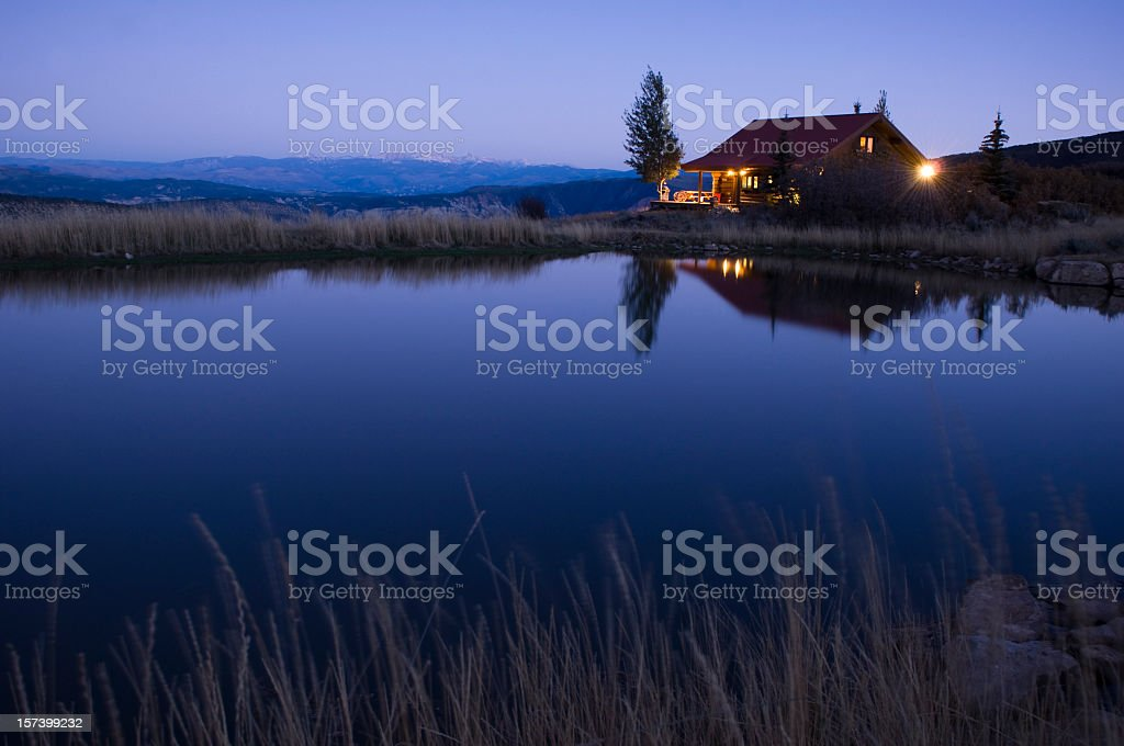 Cabin reflection in the Mountains at Dusk royalty-free stock photo