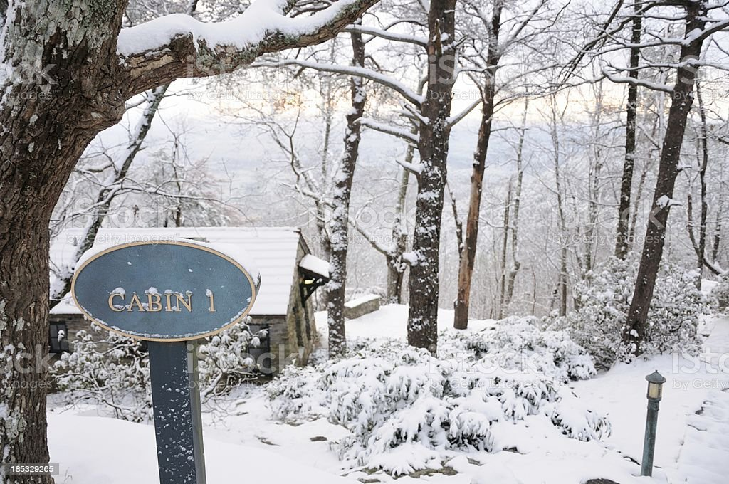 Cabin sign with snow stock photo