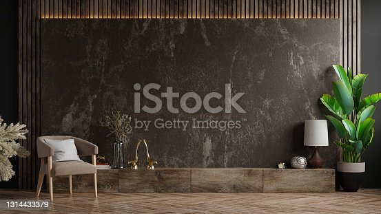 istock Cabinet TV in modern living room with armchair and plant on dark marble wall background. 1314433379