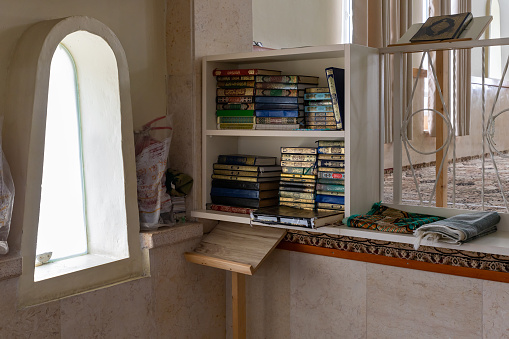 Cabinet with  holy books for prayers in the mosque in the Muslim Circassian - Adyghe village Kfar Kama, located near the Nazareth in the Galilee, in northern Israel