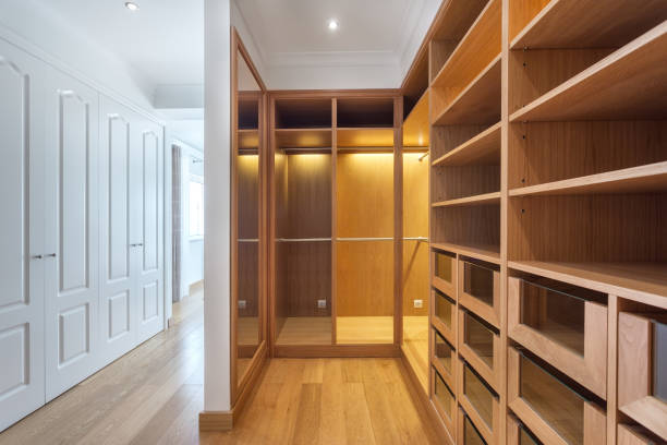 Cabinets and an empty dressing room made of wood, for family. stock photo