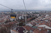 istock Cabins of overhead cable car on way to high districts of Ankara. 1204047458