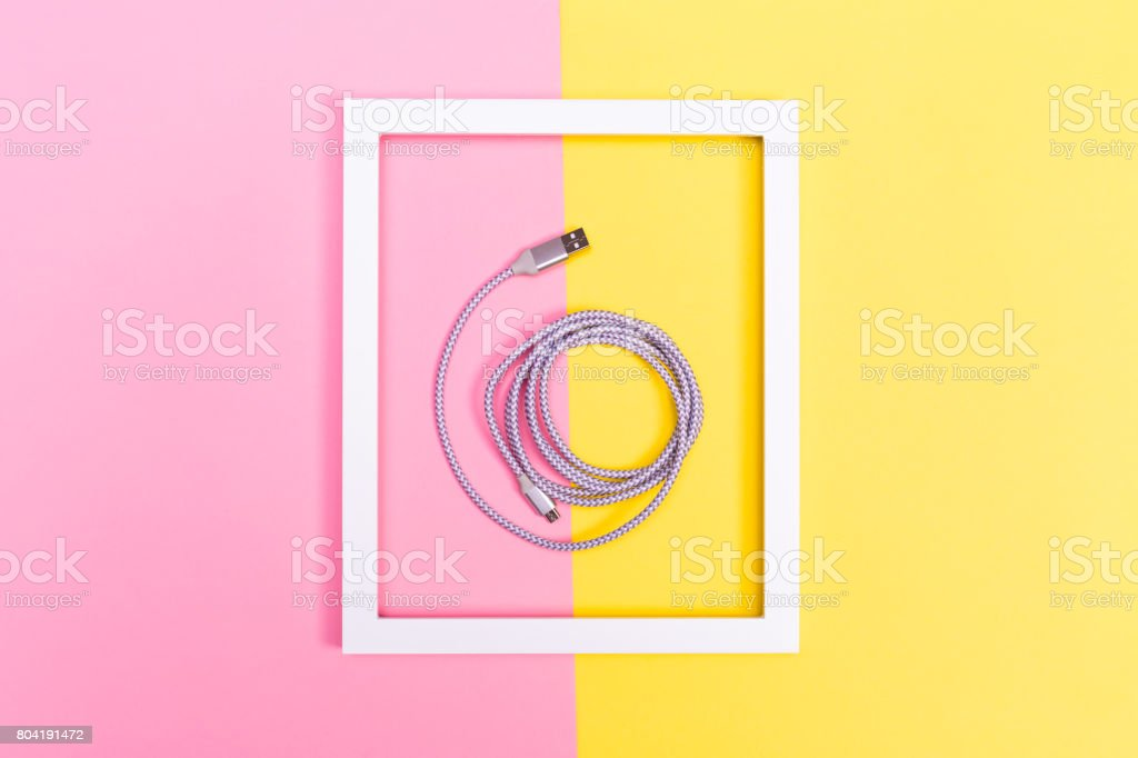 USB cable and frame on split background stock photo