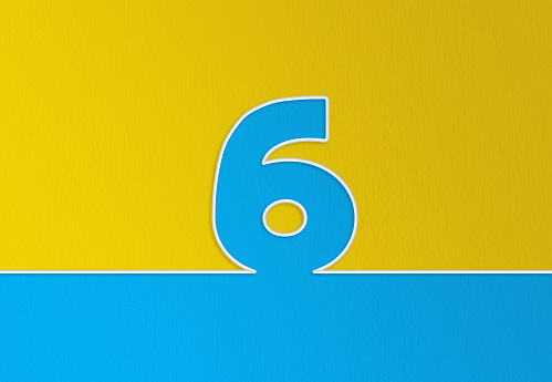 Cable and number 6 passing over yellow and blue background. Horizontal composition with copy space.
