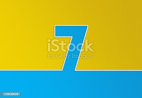 Cable and number 7 passing over yellow and blue background. Horizontal composition with copy space.