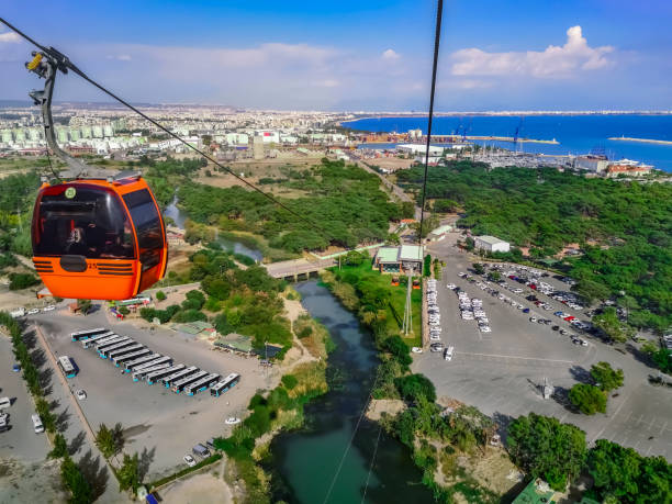 Cable car cabin close-up rides over a bright panorama of Antalya (Turkey) stock photo